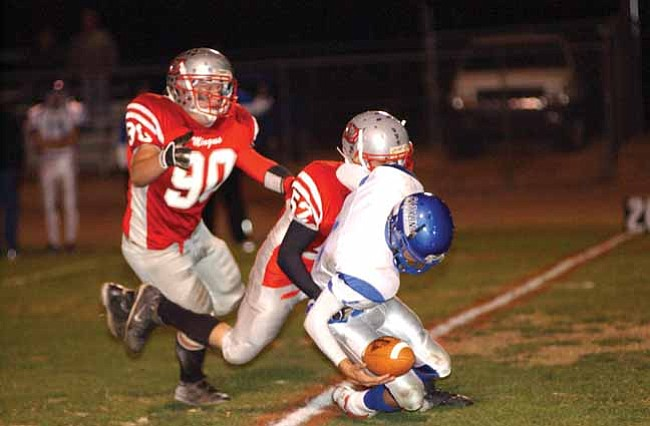 VVN/Wendy Phillippe No. 90 Devin Martinez and No. 52 Lance Helsel pursue the ball carrier. The hard impact by Helsel popped the ball out, but it was ruled down and not a fumble during the game against Catalina Friday night at the Cave. Mingus came away with the 1st round State Playoff win, 48-0.