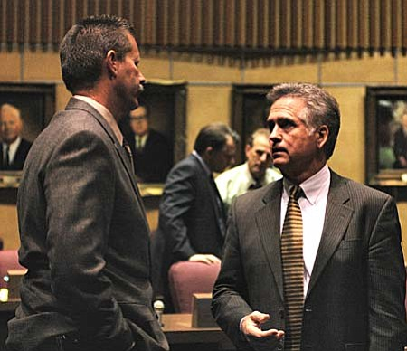 Sen. Ron Gould, left, details for Sen. John Huppenthal on Thursday why he will not support legislation to cut $300 million in state spending. (Capitol Media Services photo by Howard Fischer)