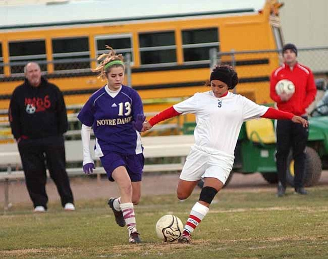 VVN/Wendy Phillippe Mackenzie Mabery battles for the ball near the sideline.