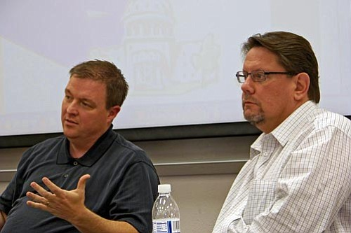 Tom Belshe and Dale Weibusch provide information at the meeting.