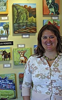 Painter Ellen Roberts with a display of small acrylic paintings she created so she would have inexpensive items to offer at the Jerome Artists Cooperative Gallery. These paintings are priced from $45 to $92. Photo by Philip Wright