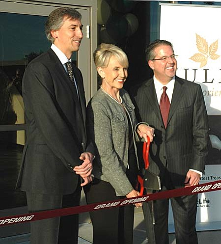 Gov. Jan Brewer on Tuesday participated in a ceremonial ribbon cutting for the new headquarters of a nutritional supplement company. Brewer wants a special legislative session Thursday on the budget but said she was not intending to ask Democrats what they need to support her plan for a sales tax referral. (Capitol Media Services photo by Howard Fischer)