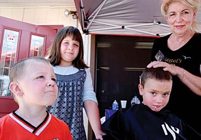 Nancy Siegel is well known for giving free haircuts to children before school started. Nancy enlisted the help of many hair stylists for that event. She later expanded the program to help people looking for work, providing haircuts to men and women. The free makeover for women included makeup. She has helped many people through donations and years of service. For five years, Nancy helped with the food program of the Old Town Mission when Jesse Gamble was director. She also worked for the Children�s Breakfast at the Assembly of God, under Pastor Peters. Nancy also helped raise money for Relay for Life for three years, and she was a member of the Chamber of Commerce for seven years. She was a contributor to the LightHeart Foundation, which provided gifts and visits to the elderly during Christmas season.