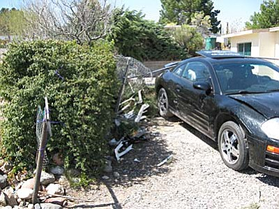 Investigators say this 2003 Mitsubishi Eclipse traveled through a chain link fence in the yard. The vehicle struck one car and then pushed that car into a mini-van. Uidenich remained trapped beneath the vehicle during the entire incident and was pronounced dead at the scene.