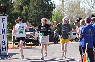"""The Mickelsens cross the finish line Saturday at Riverfront Park. <br /><br /><!-- 1upcrlf2 -->VVN/Sean Morris<br><b><u><a href=""""Formlayout.asp?formcall=userform&form=22"""">Click here to purchase photos of this event</a></b></u>"""