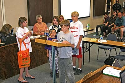 The Oak Creek School Greenies led the Pledge of Allegiance Tuesday night during the district's School Board meeting. The Greenies also took turns telling the board members about the environmental projects the club has been working on. VVN/Philip Wright<br /><br /><!-- 1upcrlf2 -->