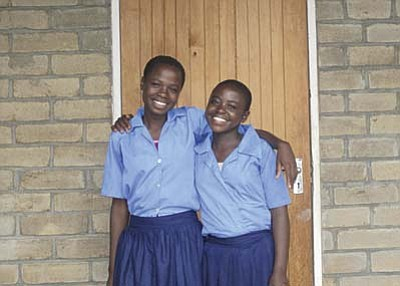 Photo courtesy of CARE/B. Kuenstler <br /><br /><!-- 1upcrlf2 -->Martha Banda (left) and classmate Mercy Khalawekha, both from Sitolo village, are all smiles now that they can continue their education with the support of a Join My Village secondary school scholarship.