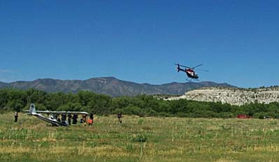 Photo courtesy of YCSO<br /><br /><!-- 1upcrlf2 -->A medical helicopter was brought to the scene for the wounded pilot.