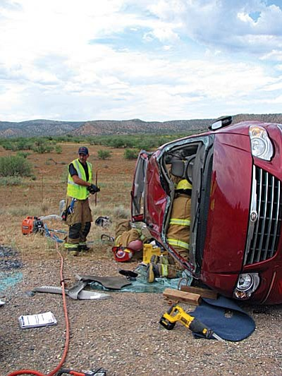 Extrication taking place in a very confined space — the passenger had to be removed through the rear of the vehicle after removal of two seats.