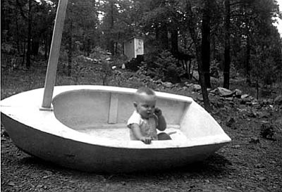 This is a boat Kevin Presmyk's father Wally Presmyk built at their cabin at Dairy Springs by Mormon Lake for Kevin and his brothers and sisters to float around in. It was in June 1959. Photo submitted by Dottie Presmyk of Camp Verde.