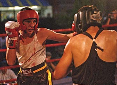 <b>Robert Gonzales</b> competes in a boxing match outside Larry Green car dealership in Cottonwood on 7/17/10. VVN/Sean Morris
