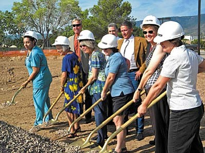 Members of the Yavapai Community Health Center and the Board of Supervisors share golden shovels to break ground Aug. 16 on the new Yavapai Community Health Clinic in Cottonwood. They include (from left) Community Health Director Peggy Nies, Tom Thurmond, Dr. James Joseph, Health Dir. Robert Resends, Supervisor Carol Springer, Carl Mattson, Prescott Free Clinic Board, Board Member Judy Kline and Supervisor Chip Davis.