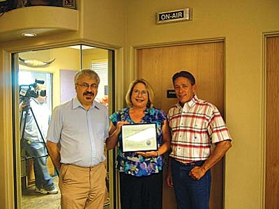 From left, Jerry Laurito, Marna Kelley, and Supervisor Chip Davis.