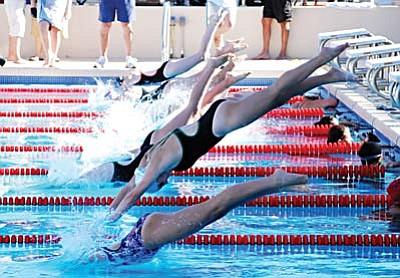 Swimmers dive into a race Thursday at the Cottonwood Aquatics Center. VVN/Jon Pelletier