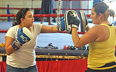 <b>Jasmin Mongi</b> works with <b>Genoa Altamirano</b> during a Monday afternoon workout at Golden Cobra Gym. VVN/Sean Morris