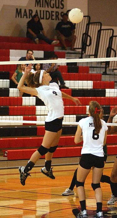 Kayla Dixon jumps for a kill off of a Delaney Scanlan set Saturday against Mohave. VVN/Sean Morris