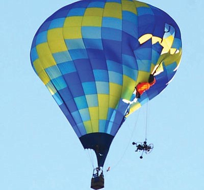 VVN/Jon Pelletier<br> A hot air balloon and a paraglider collided during Airfest at the Cottonwood Airport.