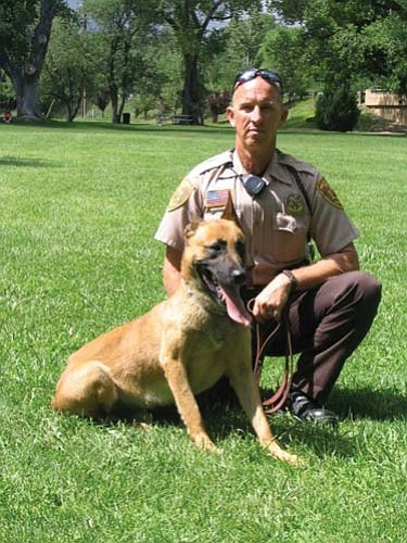 Aros (with handler Harry Schrum) will be retired after 10 years as the Yavapai County Sheriff's Office K-9.