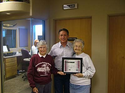 Helen Killebrew (right) received her award from Chip Davis. She was nominated by Betty Gaudy.
