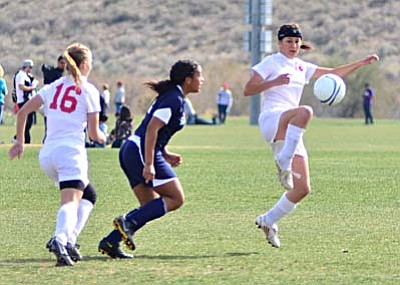 <b>Anna Guerrero</b> clears the ball during the first half against Higley Saturday at the Reach 11 Sports Complex in Phoenix. VVN/Sean Morris