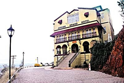 """The Jerome Grand Hotel is well known as a haunted structure. Over the years, the Altherr brothers, Robert and Larry, have had a book at the front desk of the hotel for guests to enter descriptions of their own personal experience with the hotel's ghosts. """"There is an entry at least every other day,"""" said Robert. """"It will be that somebody heard something or saw something."""" Some of the common experiences include orbs caught by cameras, or mist, or shadows – including, sometimes, a face. Other guests have reported seeing two red dots close together that appear to be floating up or down a stairwell or hallway."""