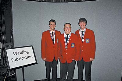 Mingus Welding Fabrication Team, John Stratz, left, Mason Hart and Kyle Alexander, won Gold for the second year in a row during the SkillsUSA State Championships in Phoenix.Courtesy Photo