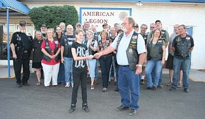 VVN/Raquel Hendrickson<br> Kelsea Freeman, 12, accepts $3,500 from the American Legion Riders of the Verde Valley Director Bill Carter and much of the chapter in Camp Verde during a meeting on May 5.