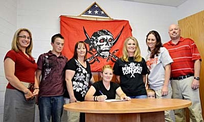 <b>Kayla Storie</b> signs a letter of intent to play softball for Glandale Community College. LEFT TO RIGHT: Principal Tamara Addis, brother Garret Storie, Mother Lisa Storie, Kayla Storie, Mingus Head Softball Coach Heather Wacker, Assistant Coach Amanda Cannon, Mingus Athletic Director Mike Boysen. VVN/Sean Morris