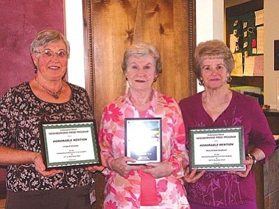 From left: Irmgard Schwabe, Honorable Mention; Joann Grant, First Place; and Dixie Goodman, Honorable Mention. Harry Goodman was unavailable.<br /><br /><!-- 1upcrlf2 -->