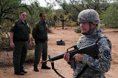 Border Patrol agents observe an unnamed Arizona National Guard soldier training for Operation Copper Cactus at an undisclosed location on Aug. 25, 2010. Operation Copper Condor is the Arizona National Guard's contribution to the up to 1,200 National Guard troops deployed to support the Border Patrol and Immigration and Customs Enforcement in four Southwest border states. U.S. Army photo by Staff Sgt. Jim Greenhill
