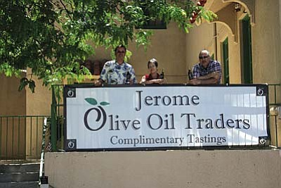 Jerome Olive Oil Traders opened at 403 Clark St., B-12 in Jerome on June 4. Shown are owner Mike Kilpatrick, left, and two employees, Bonnie Campbell and James Kirk.