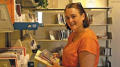 Library patron Rose Dana picks up her hold requests at SPL-V.<br /><br /><!-- 1upcrlf2 -->