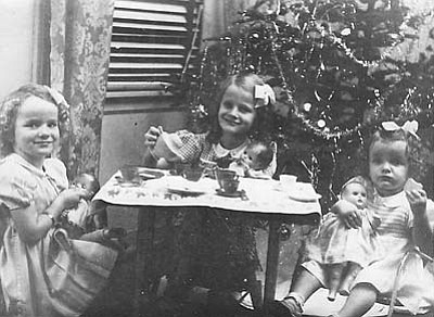 "Tea parties were very important for young girls in the '50s. The photo was taken by Sandi Ashton's father, Herman Flocken, and developed in the bathroom/bathtub in their house. Sandi Ashton: ""Although the tea set is long gone I have the table that held this tea party in my living room today."" From left: Marie Harron, Anita Smith and Sandi Ashton. Submitted by Sandi Ashton of Camp Verde."