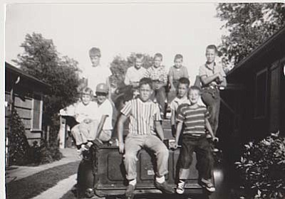 Boys 'N the Neighborhood: The picture was taken in '57 or '58 in Wilmette, Ill.  Neighborhood kids are all sitting on a 1940s Ford truck.  Dr. Earl Lord is the middle boy on the top row at about 8 or 9 years of age. Submitted by Earl Lord, DDS, of Cottonwood.