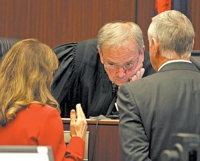 AP Photo/Deirdre Hamill, Pool<br> From left, prosecutor Sheila Polk, Judge Warren Darrow, , and defense attorney Tom Kelly, in a sidebar during the trial of James Arthur Ray in Camp Verde earlier this year..