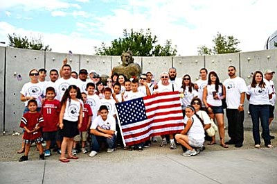 <b>The Golden Cobra crew</b> stands for a group picture next to the Pat Tillman statue outside University of Phoenix stadium on Sept. 11, 2011. VVN/Sean Morris