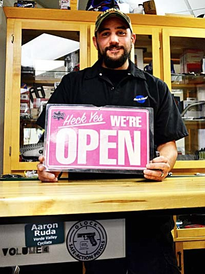 <b>Aaron Ruda</b> poses for a picture behind the counter at his bike shop, Sultana Cycles, in Cottonwood. VVN/Sean Morris