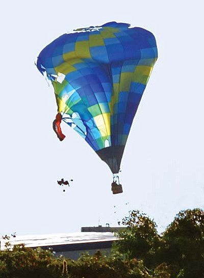 The Yavapai County Attorney's Office will not file criminal charges against the Cornville man who crashed his motorized para-glider into a hot air balloon during the Oct. 16, 2010 Cottonwood Airport Airfest. Ritchie said he flew close to the balloon in order to take pictures of it.