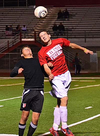 <b>Andrew Hickey</b> wins a header in a scrimmage Wednesday against North Canyon. VVN/Sean Morris