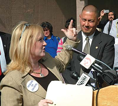 Gerri Hills, vice president of Arizonans for Gun Safety, speaks out against legislation that would allow adults with concealed-carry permits to have their guns on college and university campuses. She said it's irrelevant that five other states already have similar laws without incidents. With her is Sen. Steve Gallardo, D-Phoenix, who also is opposed to the measure. (Capitol Media Services photo by Howard Fischer)