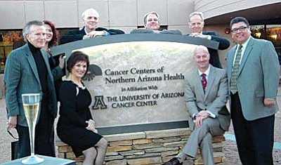 The leadership of the Verde Valley Medical Center and of University of Arizona Cancer Center pose before the new monument sign which recognizes the affiliation. VVN/Jon Hutchinson