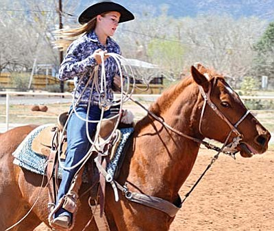 Sharli MacDonald, 15, practices calf roping. She is one of three Camp Verde teens who compete on the high school rodeo circuit.