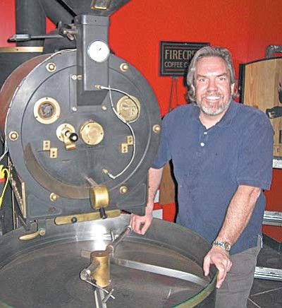 "Standing by his trusty roaster, Firecreek Coffee Company owner Mike Funk invites you to ""come on in"" and enjoy the nuances of great coffee."