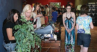 In-store traffic was heavy Friday morning in the new store of Verde Valley Olive Oil Traders at 1002 N. Main St. in Old Town Cottonwood. The store had opened in the new location on March 26.
