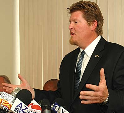 Rep. Daniel Patterson answers questions Tuesday from reporters about the charges against him. Patterson said he is not guilty and said the process is being rushed. (Capitol Media Services photo by Howard Fischer)