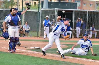 Camp Verde starter Jesse Fullbright fields a bunt and throws to first, but the runner is safe Tuesday against Snowflake in the first round of the Division III baseball state playoffs. VVN/Sean Morris *Photo published with permission from the AIA.