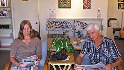 Diane Hughes and Larry Smith enjoy reading magazines and newspapers at SPL-V.