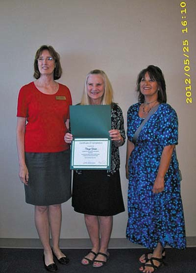 Cheryl Yeatts (center), Manager of SPL-V, accepts certificate from Janet Fisher (left), Acting State Librarian, and Susan Lapis (right), District Assistant Director, Yavapai County Library.