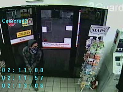 This surveillance video image shows the armed robber entering the Shell station at 898 S. Main St. at about 2:15 Thursday morning.