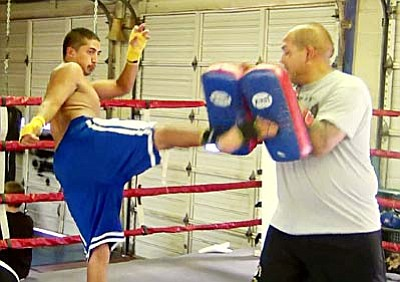 "<b>Jesse Duran</b> trains at Golden Cobra with his father Robert Gonzales in preparation for ""Bronze Beauties and Beatdowns"" at Players sports bar in Cottonwood. Courtesy Photo"